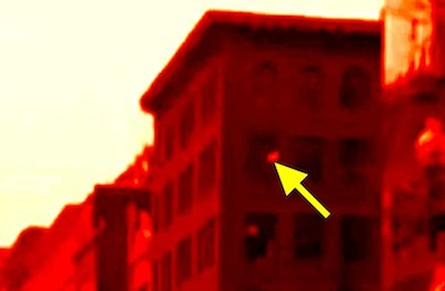 Boston Marathon bomb debris entering window of building revealed by video forensic analysis. Click the above picture to view the video showing how this was uncovered.